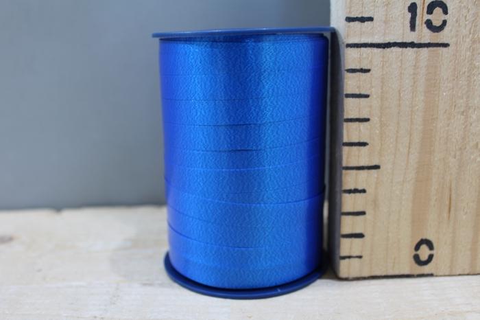<h4>CURLY RIBBON 10MM X 250M D.BLUE 614</h4>